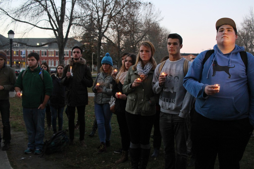 Students stand in solidarity with victims of global terrorism at a candlelight vigil hosted by the French Club on the Fogler Library steps, Tuesday, Nov. 17.