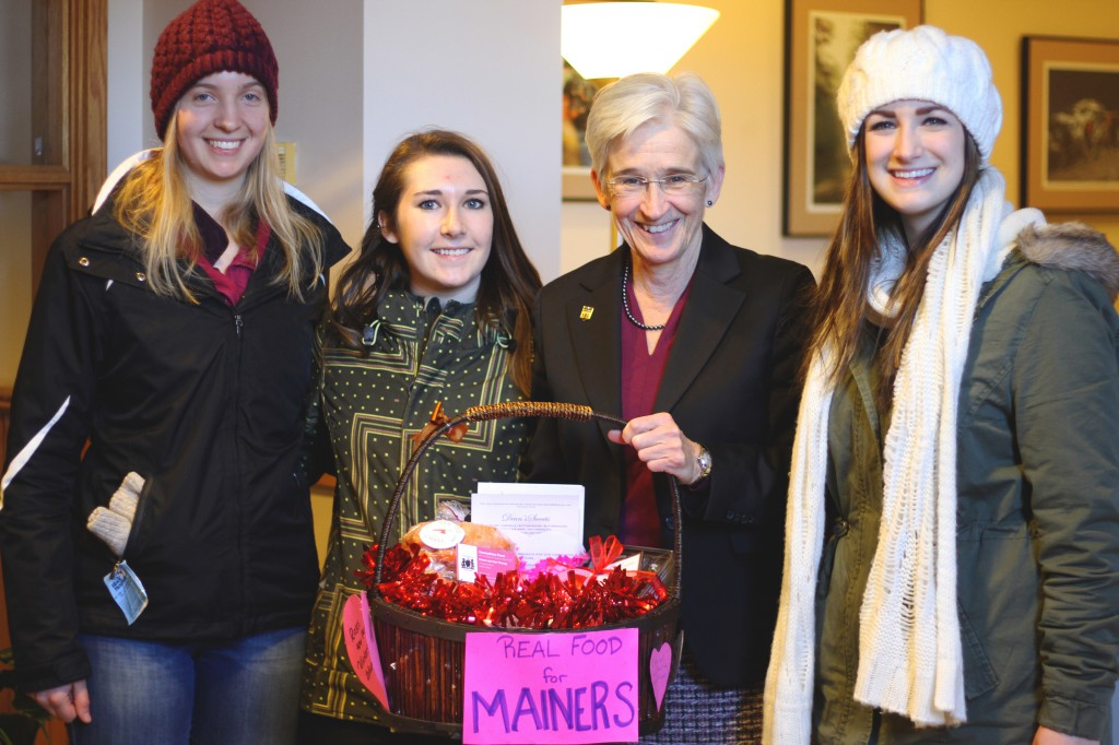 Currenn Mackie-Malcolm (left), Robin Pelkey (middle), and Gabby Cyr (right) with President Susan Hunter after choosing the Real Food for Mainer's basket.