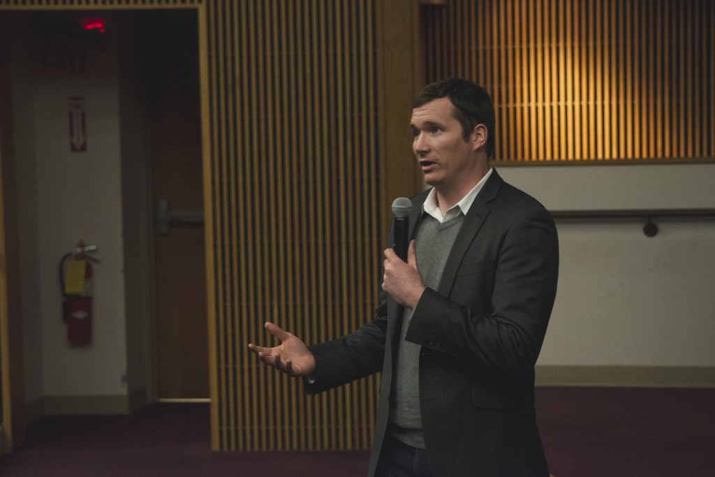 "Survivor of the 2007 Virginia Tech Shooting, Colin Goddard, addresses students at the viewing of ""Living For 32"" hosted by for Maine Athletes Against Violence (MAAV) and Maine Moms Demand Action for Gun Sense on Wednesday in DPC. Photo by Maggie Gautrau, staff."