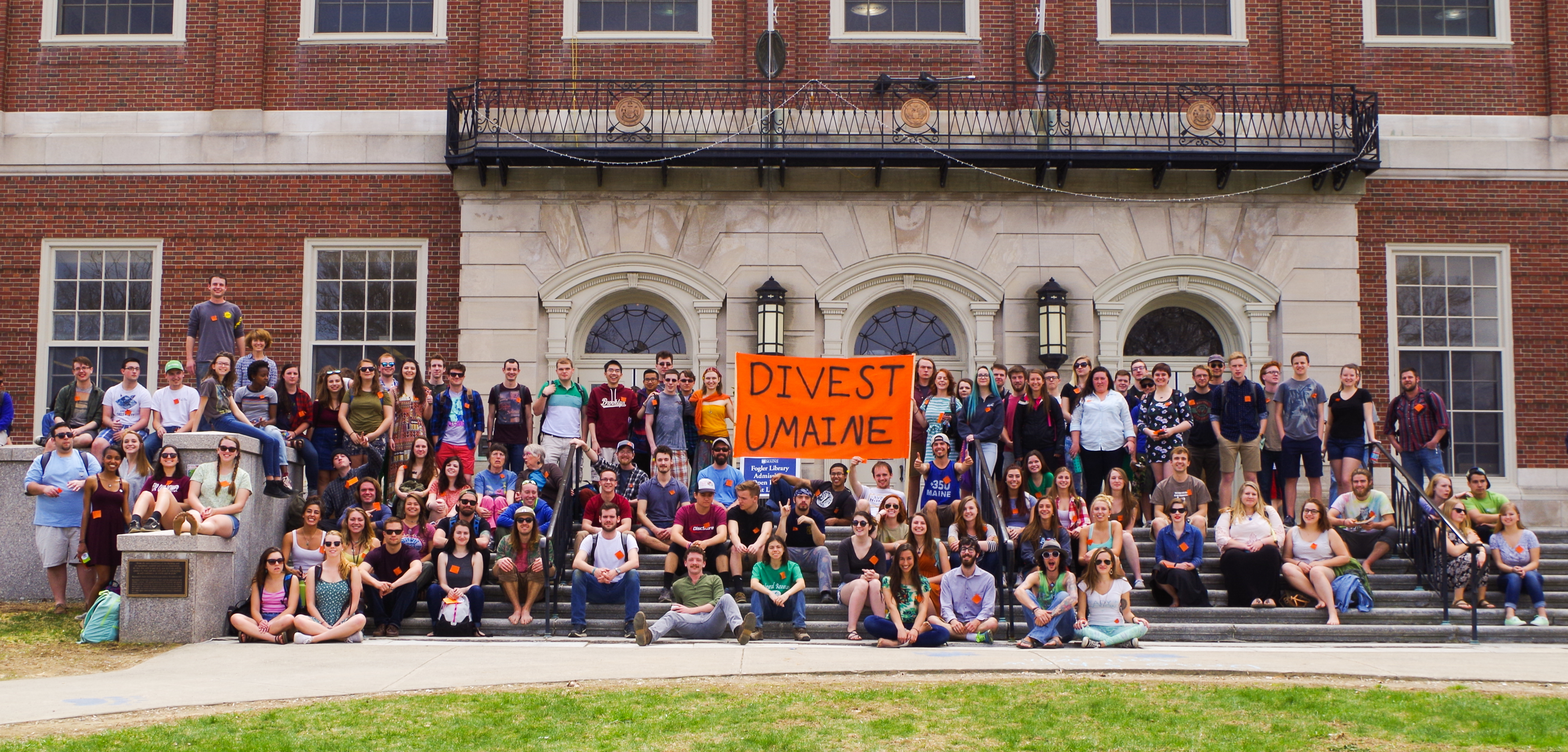 The organization Divest UMaine poses on the Fogler Library steps during the EarthFest celebration on Friday, April 22, 2016. Divest UMaine tabled at the event and spread awareness about their efforts to encourage the UMaine Board of Trustees to divest from fossil fuels.